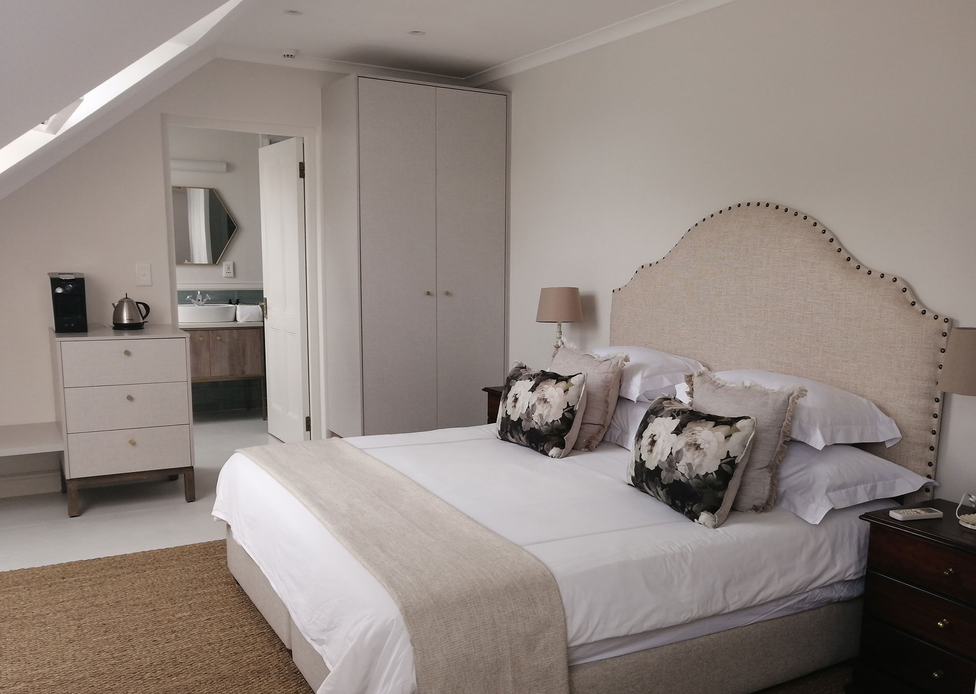 Bedroom at The Chapter House Boutique Hotel